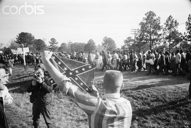 White Youth Holding Confederate Flag at March